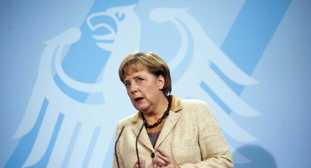 German Chancellor Angela Merkel  in front of Germany's heraldic eagle.