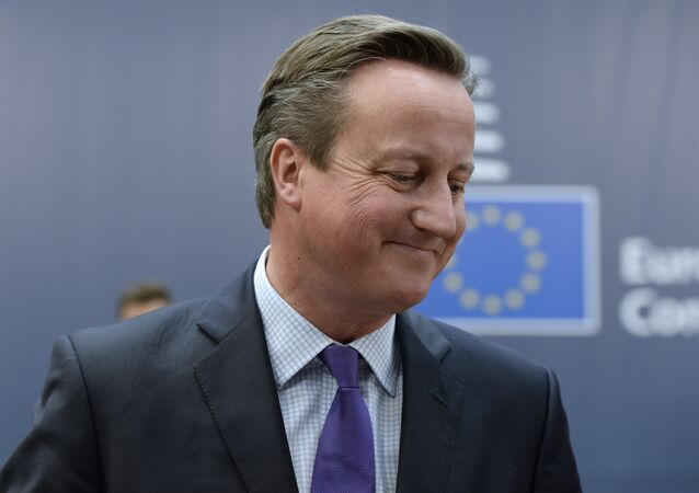 British Prime Minister David Cameron arrives to take part in a European Union (EU) summit dominated by the migration crisis at the European Council in Brussels, on October 15, 2015