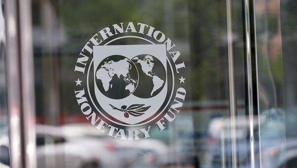 The seal of the International Monetary Fund is seen at the headquarters building in Washington, DC on July 5, 2015 - Sputnik International