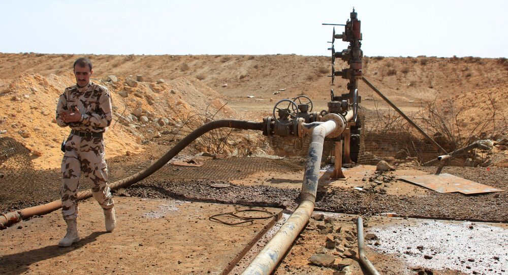 A member of the Syrian government forces walks next to a well at Jazel oil field, near the ancient city of Palmyra in the east of Homs province after they retook the area from Daesh. File photo
