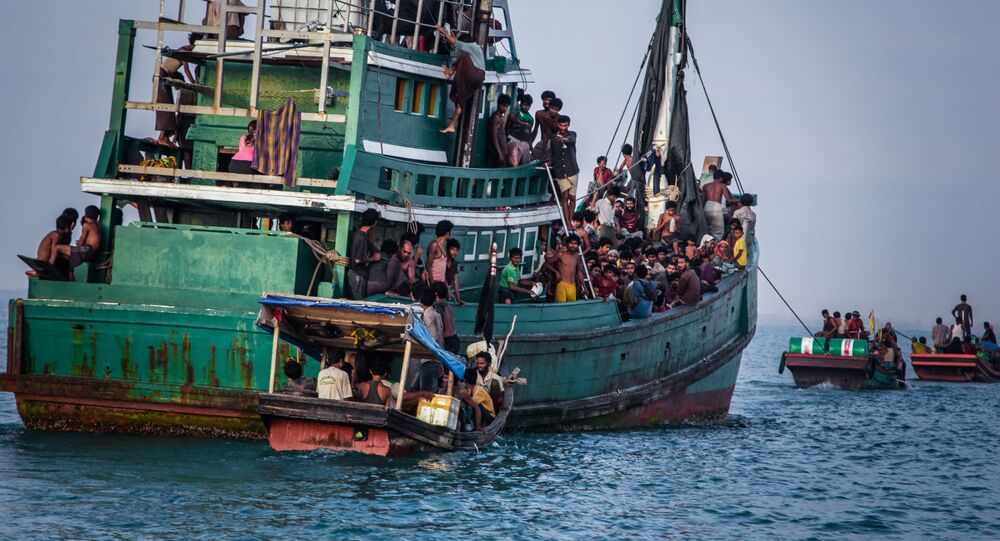 In this photo taken on May 20, 2015 shows Rohingya migrants resting on a boat off the coast near Kuala Simpang Tiga in Indonesia's East Aceh district of Aceh province before being rescued