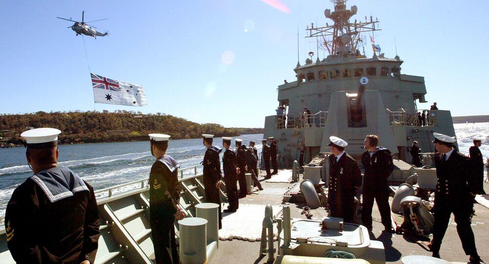 Sailors stand aboard Australia's HMAS Stuart on Friday, Sept. 10, 2004.