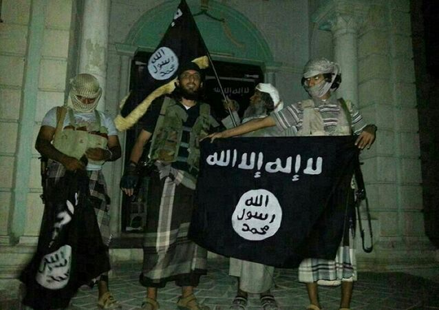 A picture taken with a mobile phone early on May 24, 2014 shows Al-Qaeda militants posing with Al-Qaeda flags.