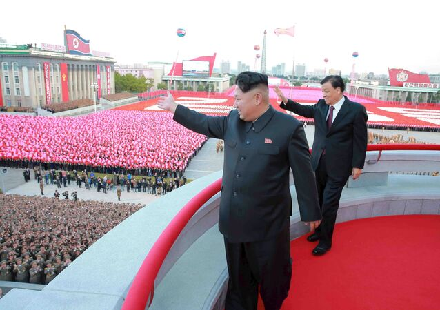 North Korean leader Kim Jong Un (L) and senior Chinese Communist Party official Liu Yunshan (R) wave during celebration of the 70th anniversary of the founding of the ruling Workers' Party of Korea, in this undated photo released by North Korea's Korean Central News Agency (KCNA) in Pyongyang on October 12, 2015