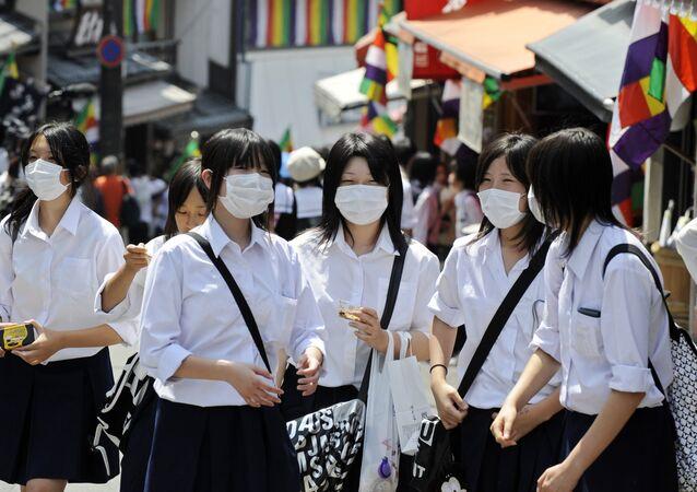 Japanese school girls wearing facemasks