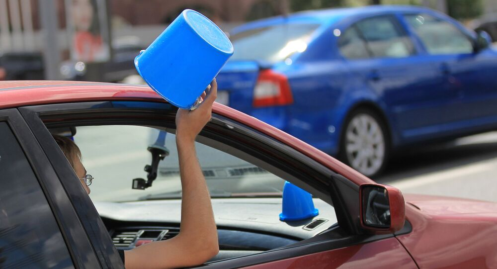 Blue Pail car rally along Garden Ring in Moscow. The drivers attached blue plastic pails onto their cars