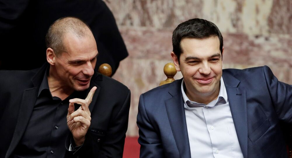 Greece's Prime Minister Alexis Tsipras, right, and Finance Minister Yanis Varoufakis chat during a Presidential vote in Athens, on Wednesday, Feb. 18, 2015.
