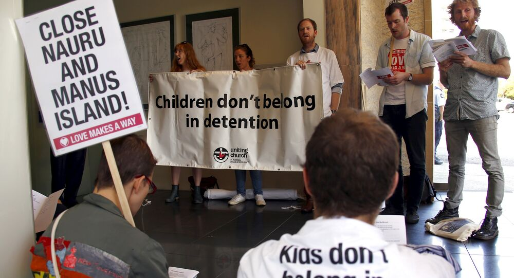 A group of around twenty protesters occupy Australian Prime Minister Malcolm Turnbull's electoral office, demanding the end to the policy of offshore detention of asylum seekers, in the Sydney suburb of Edgecliff, Australia, October 14, 2015