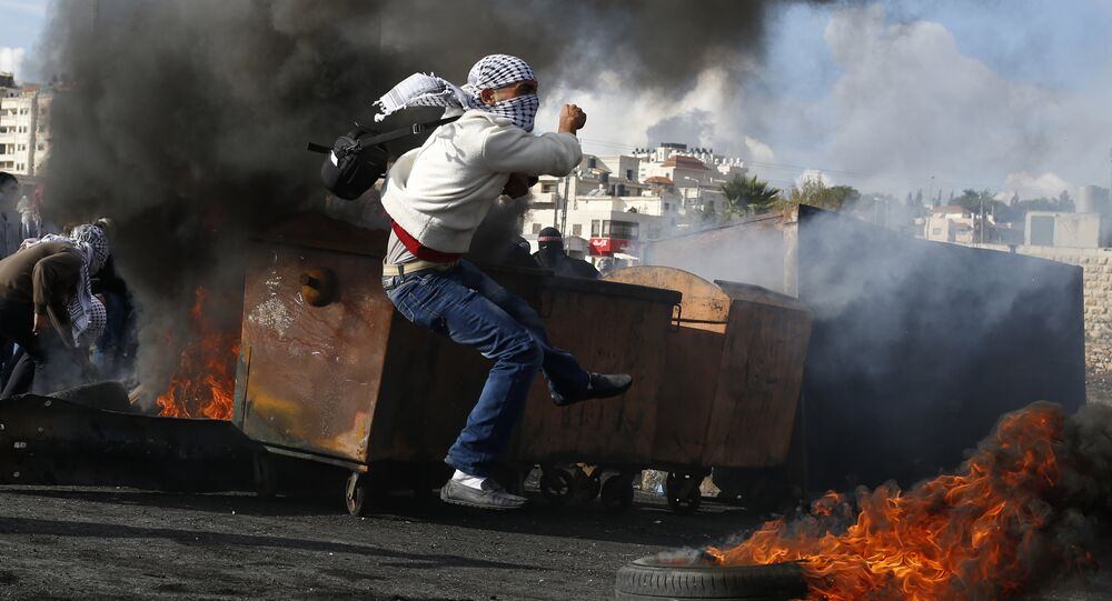 Palestinian students of the Birzeit University clash with Israeli security forces at the northern entrance of the West Bank town of Al-Bireh, on the northern outskirts of Ramallah, on October 29, 2015
