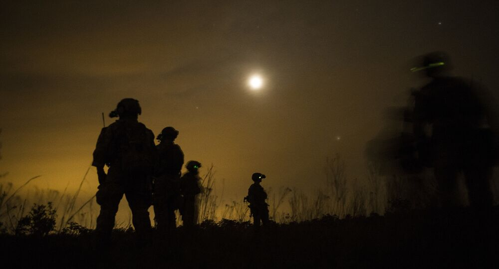 U.S. Army Soldiers from the 7th Special Forces Group prepare to leave the drop zone during fast rope insertion and extraction training as part of Emerald Warrior at Hurlburt Field, Fla., April 22, 2015. Emerald Warrior is the Department of Defense's only irregular warfare exercise, allowing joint and combined partners to train together and prepare for real-world contingency operations.