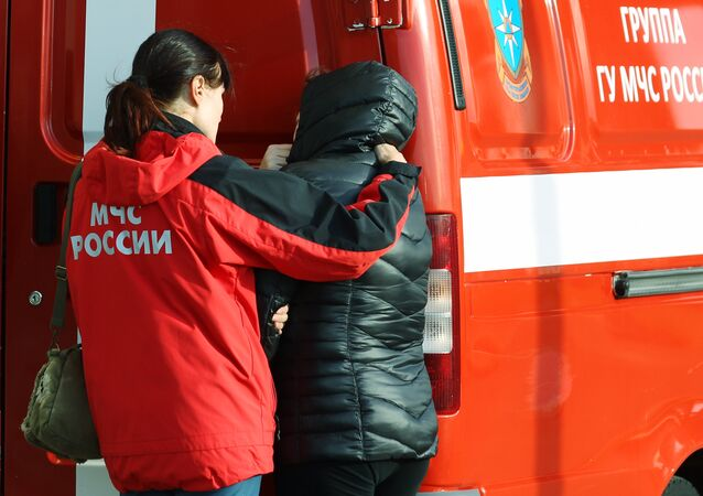 An Emergencies Ministry counselor helps a relative of Flight 9268 passengers at Pulkovo airport, the destination of the Kogalymavia Airlines Airbus A321 en route from Sharm el-Sheikh
