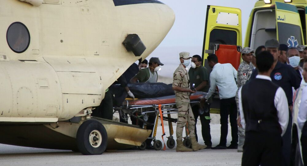 An Egtptian search and rescue crew transfers the body of a victim of a plane crash from a civil police helicopter to an ambulance at Kabrit airport in Suez, 100 kilometers east of Cairo, Egypt, Saturday, Oct. 31, 2015