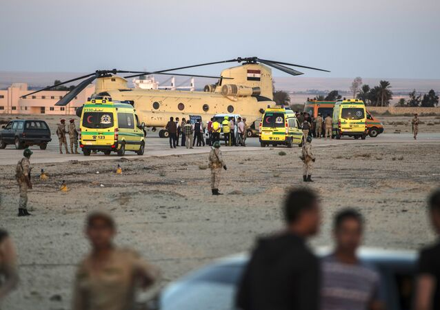 Egyptian ambulances carrying the corpses of Russian victims of a Russian passenger plane crash in the Sinai Peninsula, off load the bodies into a military aircraft at Kabret military air base by the Suez Canal on October 31, 2015