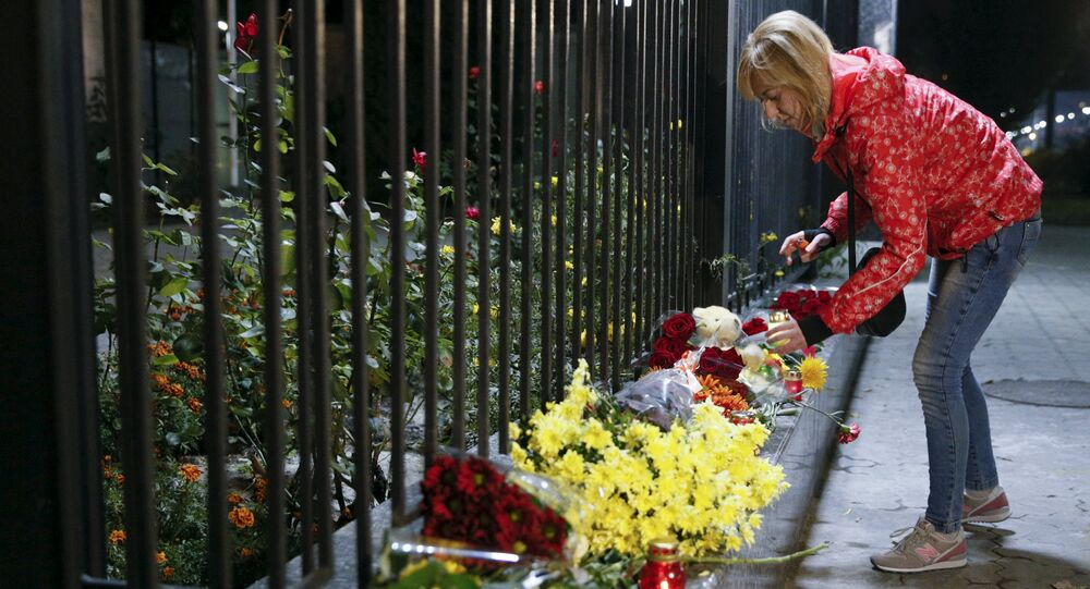A woman places a candle for victims of a Russian airliner which crashed in Egypt, outside the Russian embassy in Kiev, Ukraine October 31, 2015
