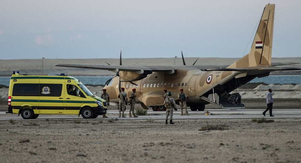 Egyptian ambulance waits at Kabret military air base by the Suez Canal on October 31, 2015, after victims of a Russian airliner that crashed in the Sinai Peninsula were brought to the base before being transported to a morgue. Egypt's government said 15 bodies have been recovered and transferred to a morgue so far from the site of the crash