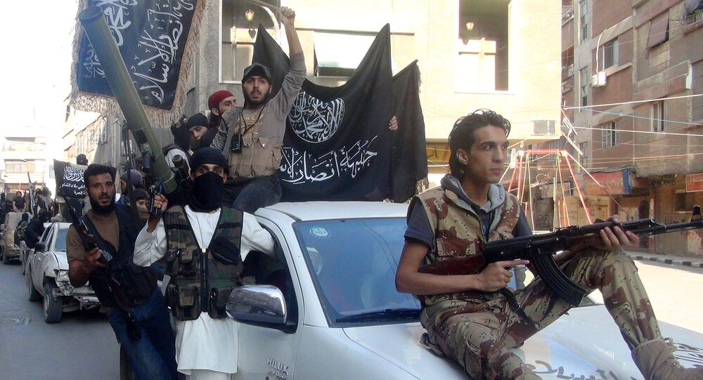 Islamic fighters from the al-Qaida group in the Levant, Al-Nusra Front, wave their movement's flag as they parade at the Yarmuk Palestinian refugee camp, south of Damascus, to denounce Israel's military offensive on the Gaza Strip, on July 28, 2014.