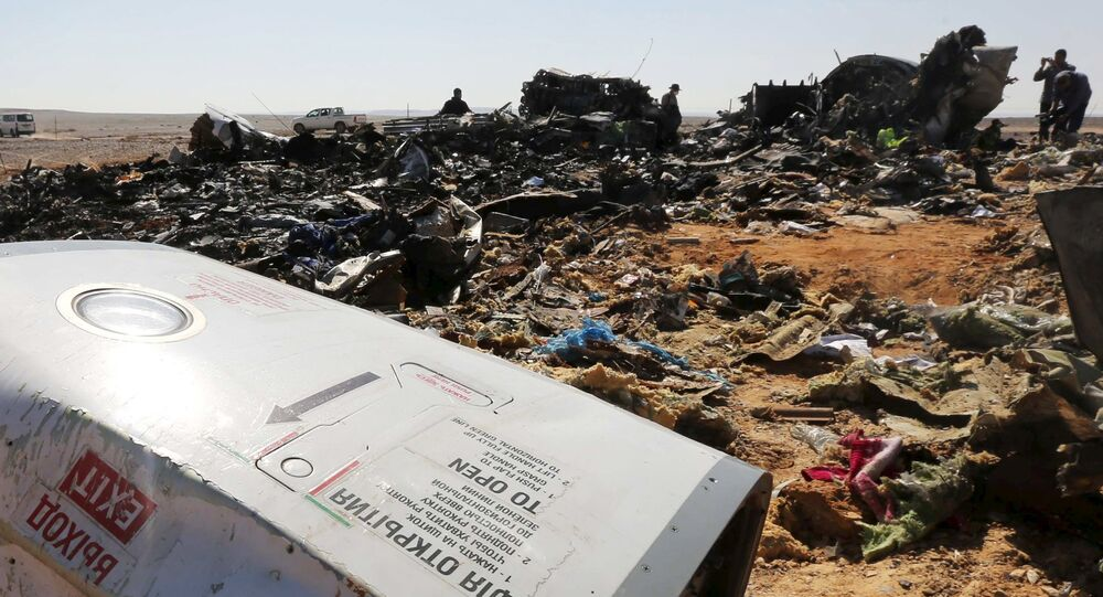 The remains of a Russian airliner are inspected by military investigators at the crash site at the al-Hasanah area in El Arish city, north Egypt, November 1, 2015
