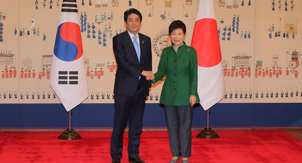 Japanese Prime Minister Shinzo Abe shakes hands with South Korean President Park Geun-hye before bilateral summit at the Presidential Blue House in Seoul, South Korea, November 2, 2015