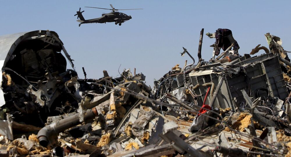 Egyptian Military Helicopter Flies Over Debris From Russian Airbus A321