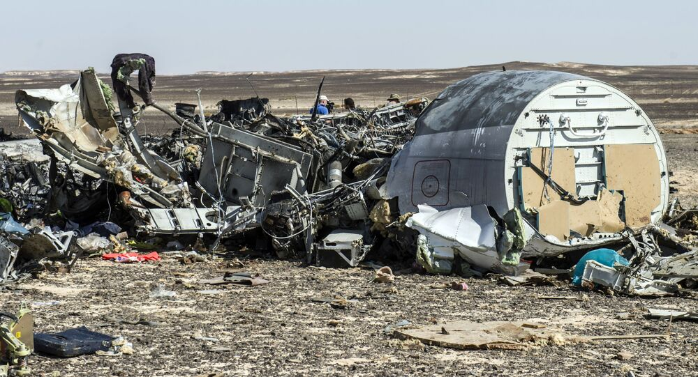 Debris belonging to the A321 Russian airliner are seen at the site of the crash in Wadi el-Zolmat, a mountainous area in Egypt's Sinai Peninsula on November 1, 2015. International investigators began probing why a Russian airliner carrying 224 people crashed in Egypt's Sinai Peninsula, killing everyone on board, as rescue workers widened their search for missing victims.