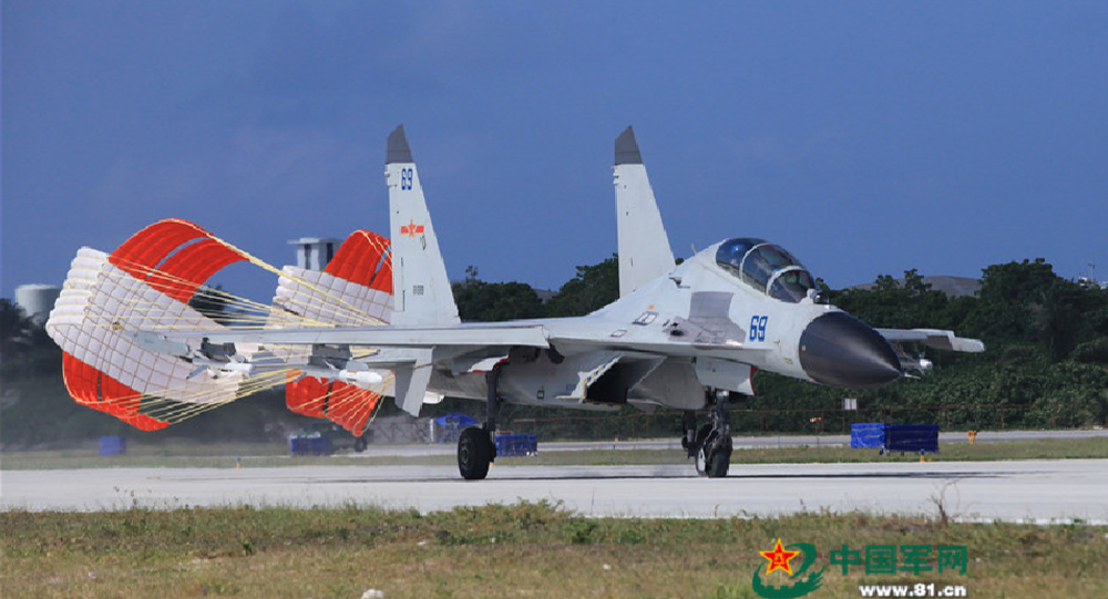 A J-11 fighter taxis on the runway after returning from a flight training on Oct. 30, 2015.