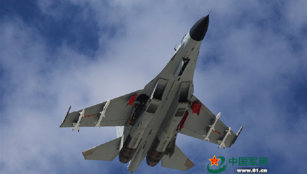 A J-11 fighter flies above the South China Sea on 30 October 2015. An aviation division under the South China Sea Fleet of the Chinese PLA Navy carried out on Friday training on real air battle tactics.  - Sputnik International
