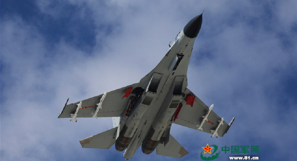 A J-11 fighter flies above the South China Sea on Oct. 30, 2015. An aviation division under the South China Sea Fleet of the Chinese PLA Navy carried out on Friday training on real air battle tactics.