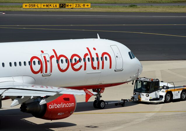 A photo taken on August 3, 2015 shows an Airbus of German airline Air Berlin on the runway in Duesseldorf, western Germany.