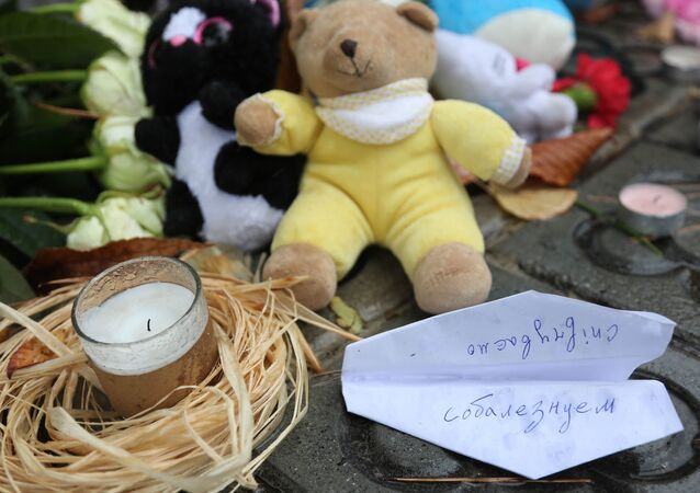 Flowers, candles, toys and a paper plane with the word condolences to commemorate the Airbus A321 victims, outside the Russian general consulate in Barcelona