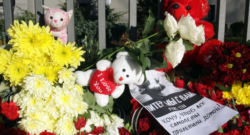 Flowers, candles and toys to commemorate the Airbus A321 victims, outside the Russian general consulate in Riga
