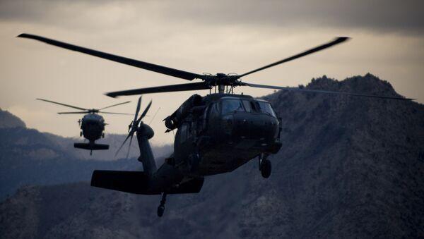 Two Army UH-60 Black Hawk helicopters prepare for landing at forward operating base Kalagush. - Sputnik International