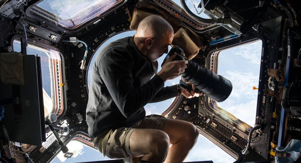 Spacewalking astronaut loses mirror, newest space junk