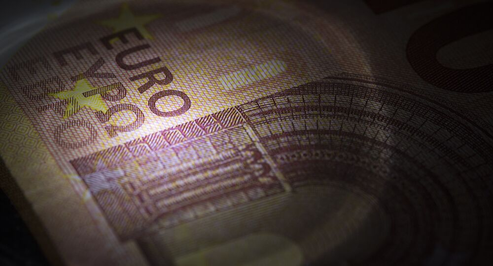 A picture taken on July 6, 2015 in Paris show 10-euro banknotes.