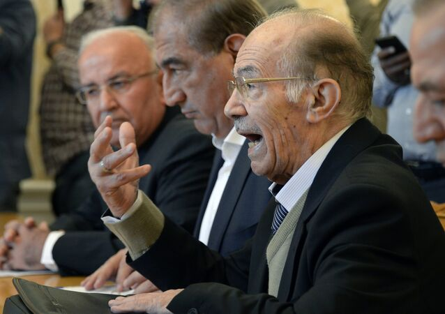 Head of the National Coordination Committee for Democratic Change, Hassan Abdel Azim (R) and other members of the Syrian tolerated opposition.