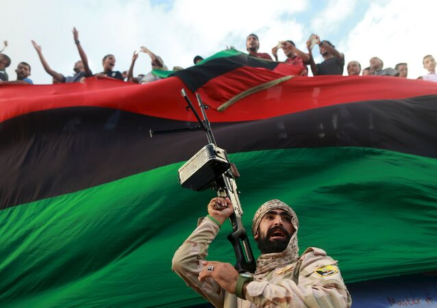 One of the members of the military protecting a demonstration against candidates for a national unity government proposed by U.N. envoy for Libya Bernardino Leon, is pictured in Benghazi, Libya October 23, 2015.