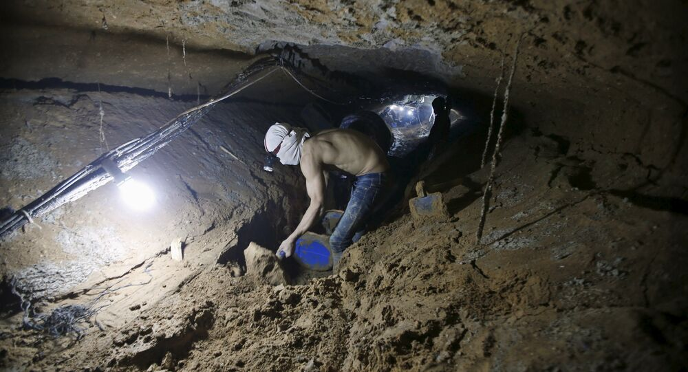 A Palestinian worker repairs a smuggling tunnel after it was flooded by Egyptian security forces, beneath the border between Egypt and southern Gaza Strip November 2, 2015.