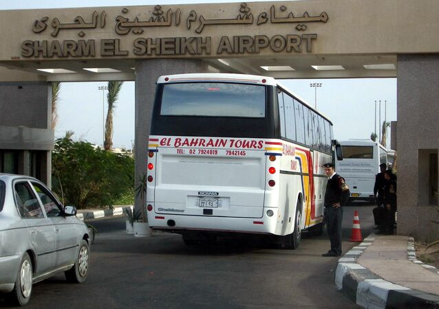 A tour bus passes Egyptian security as it arrives at Sharm El Sheikh International Airport