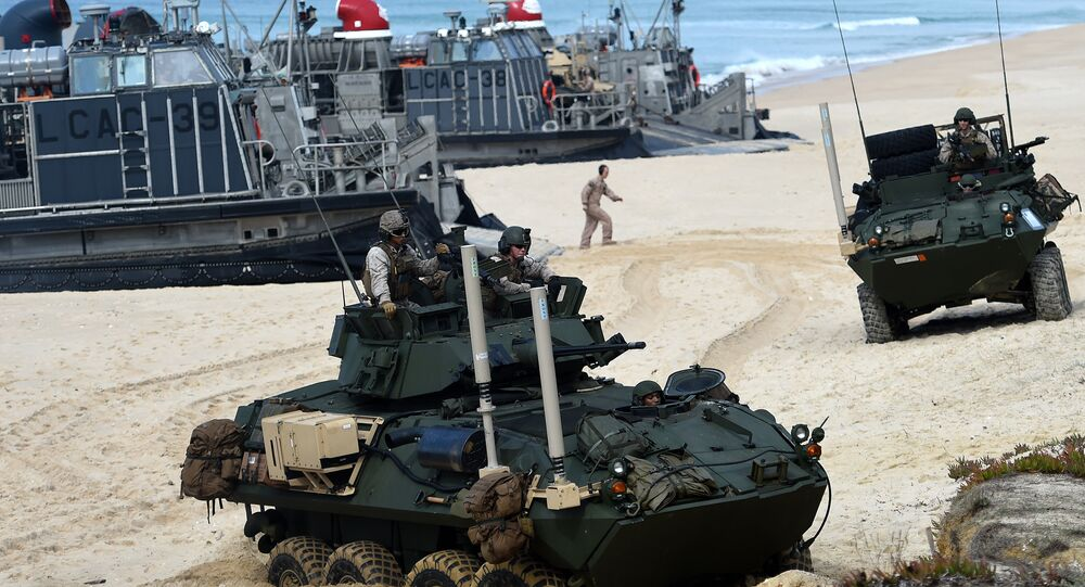 US marines disembark their armoured vehicles from the overcrafts deploid by the USS Arlington amphibious transport dock during the NATO's Trident Juncture exercise at Pinheiro da Cruz beach, south of Lisbon, near Grandola on October 20, 2015