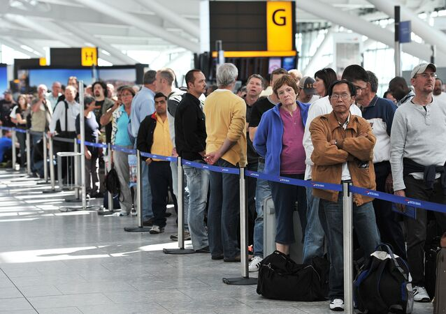 Passengers wait in line for British Airways flights. File photo