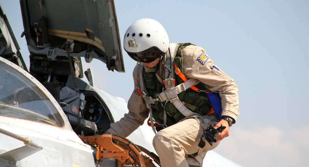 Russian pilot gets into a Su-24 aircraft before taking off at the Khmeimim airbase in Syria. File photo