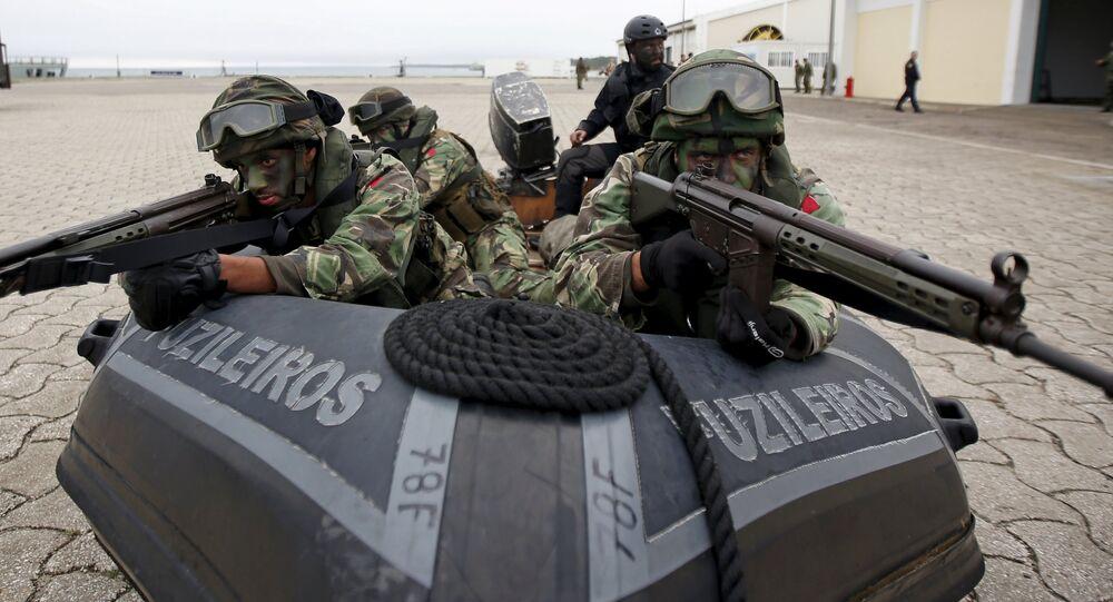 NATO soldiers participate in NATO Exercise Trident Juncture in Troia, near Setubal, Portugal November 5, 2015.