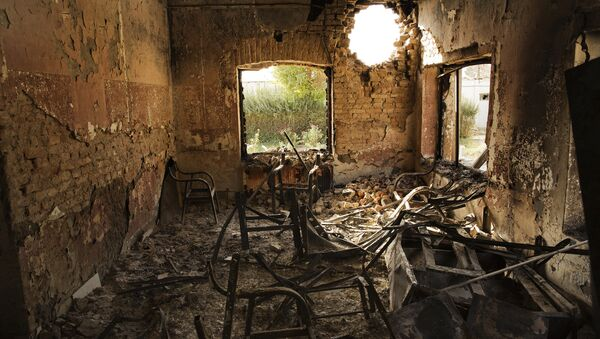 An interior view of the MSF Trauma Centre, 14 October 2015, shows a missile hole in the wall and the burnt-out remians of the the building aftera sustained attack on the facility in Kunduz, northern Afghanistan - Sputnik International