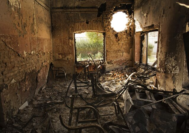 An interior view of the MSF Trauma Centre, 14 October 2015, shows a missile hole in the wall and the burnt-out remians of the the building aftera sustained attack on the facility in Kunduz, northern Afghanistan