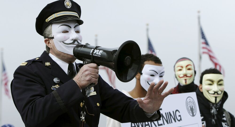 Captain Lewis, a retired Philadelphia police officer, protests with members of the Anonymous Army, with their signature Guy Fawkes masks, in front of the Washington Monument in Washington, November 5, 2015.Captain Lewis, a retired Philadelphia police officer, protests with members of the Anonymous Army, with their signature Guy Fawkes masks, in front of the Washington Monument in Washington, November 5, 2015.