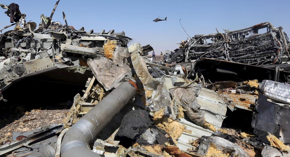 he remains of a Russian airliner are seen as an Egyptian military helicopter flies over the crash site in al-Hasanah area at El Arish city, north Egypt, November 1, 2015
