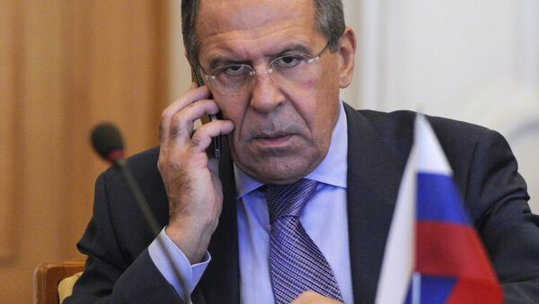 Russian Foreign Minister Sergey Lavrov speaks on the phone during a meeting with the Ukraine's Foreign Minister Kostyantyn Gryshchenko in Kiev, Ukraine, Friday, Oct. 19, 2012 - Sputnik International