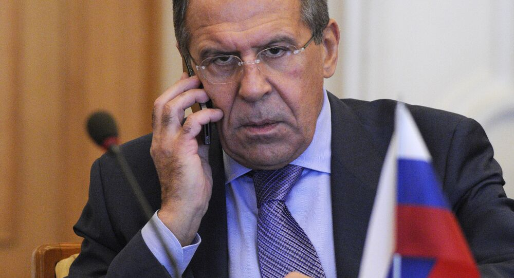 Russian Foreign Minister Sergey Lavrov speaks on the phone during a meeting with the Ukraine's Foreign Minister Kostyantyn Gryshchenko in Kiev, Ukraine, Friday, Oct. 19, 2012