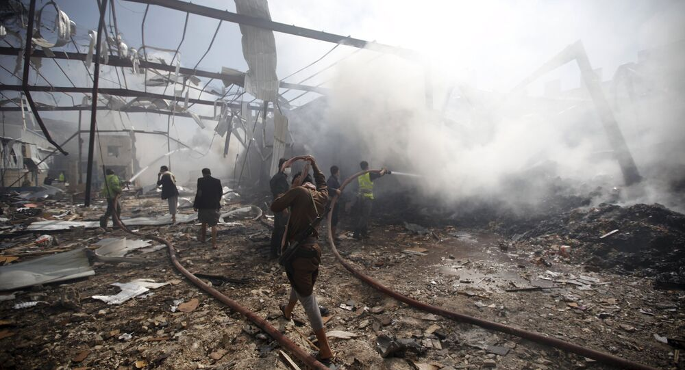 Firefighters extinguish a fire at a food storage warehouse hit by a Saudi-led air strike in Yemen's capital Sanaa October 25, 2015