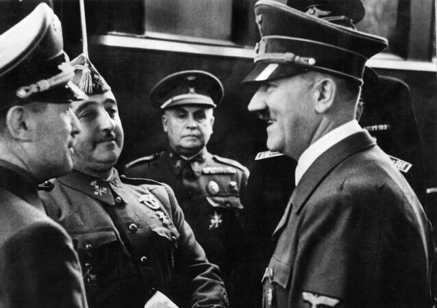 Nazi leader German Chancellor Adolf Hitler (R) shakes hands with Spanish Generalissimo Francisco Franco at Hendaye train station on the French-Spanish border 23 October 1940.