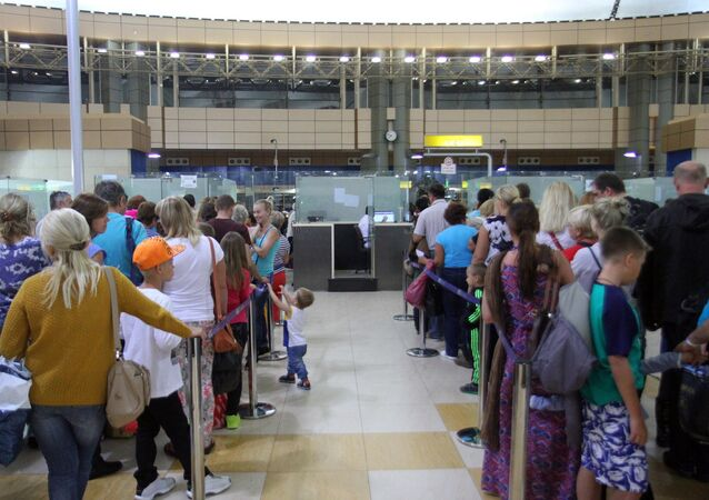 Tourists queue at a security check in the airport in Egypt's Red Sea resort of Sharm El-Sheikh on November 5, 2015